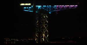 Titan Clydebank lit up in pink & blue